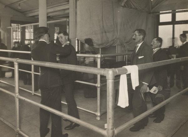 Medical inspection of men at Ellis Island